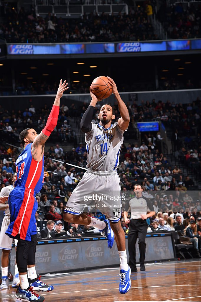 Darius Morris of the Brooklyn Nets shoots the ball against the Detroit Pistons on December 21 2014 at the Barclays Center in Brooklyn NY NOTE TO USER...