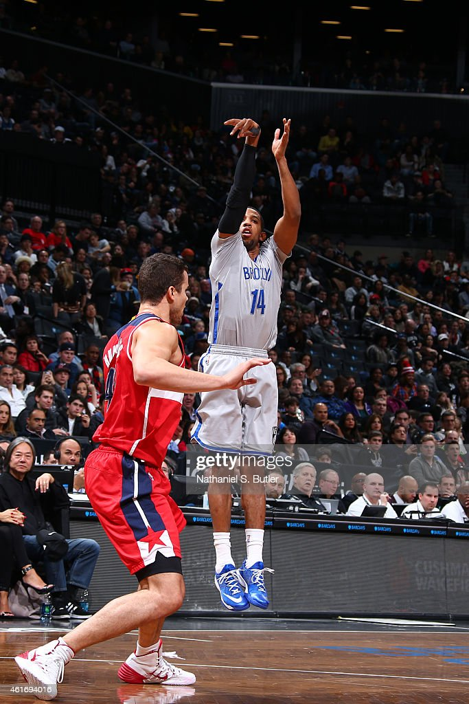 Darius Morris of the Brooklyn Nets shoots the ball against the Washington Wizards during the game on January 17 2015 at Barclays Center in Brooklyn...