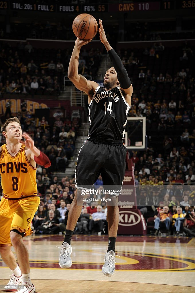 Darius Morris of the Brooklyn Nets takes a shot against the Cleveland Cavaliers on March 18 2015 at Quicken Loans Arena in Cleveland Ohio NOTE TO...
