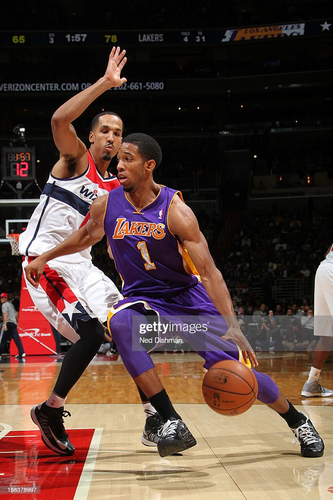 Darius Morris #1 of the Los Angeles Lakers drives against Shaun Livingston #14 of the Washington Wizards during the game at the Verizon Center on December 14, 2012 in Washington, DC.