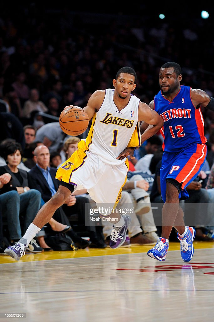 Darius Morris #1 of the Los Angeles Lakers drives against <a gi-track='captionPersonalityLinkClicked' href=/galleries/search?phrase=Will+Bynum&family=editorial&specificpeople=212891 ng-click='$event.stopPropagation()'>Will Bynum</a> #12 of the Detroit Pistons at Staples Center on November 4, 2012 in Los Angeles, California.