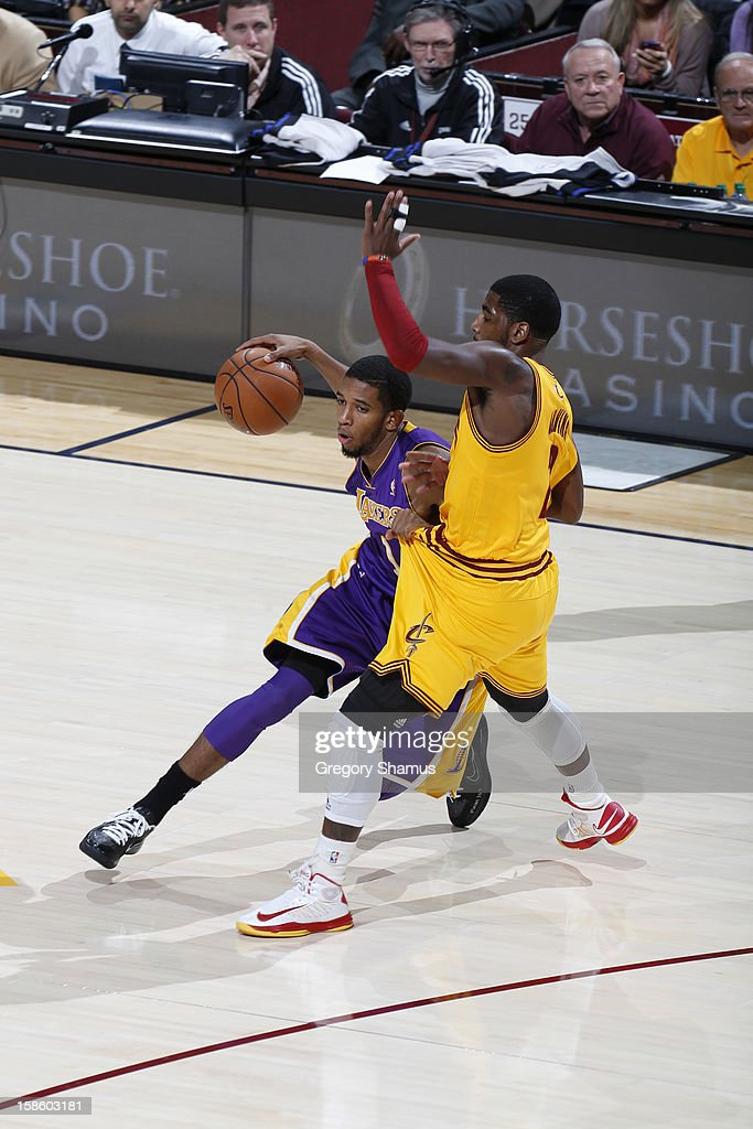 Darius Morris #1 of the Los Angeles Lakers drives to the basket against <a gi-track='captionPersonalityLinkClicked' href=/galleries/search?phrase=Kyrie+Irving&family=editorial&specificpeople=6893971 ng-click='$event.stopPropagation()'>Kyrie Irving</a> #2 of the Cleveland Cavaliers at The Quicken Loans Arena on December 11, 2012 in Cleveland, Ohio.
