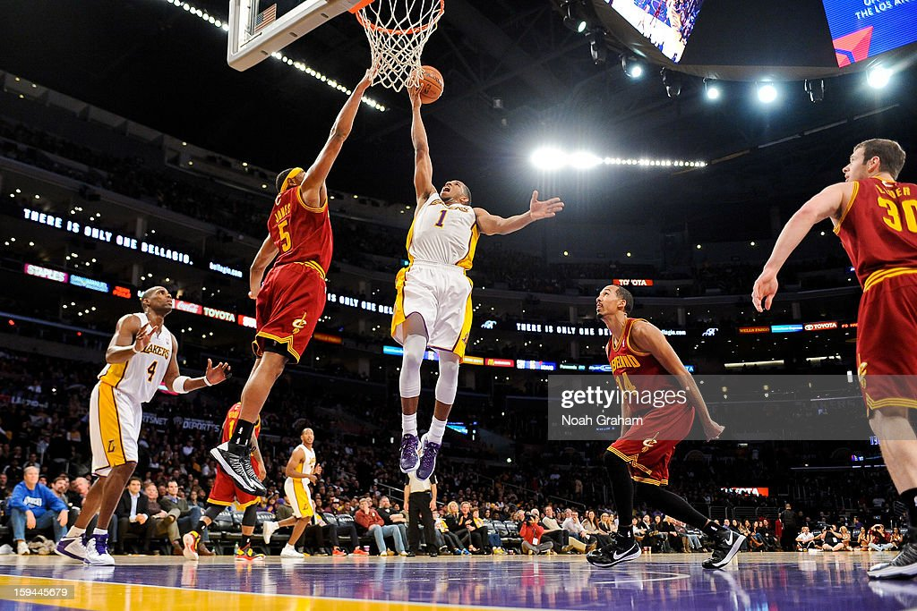 Darius Morris #1 of the Los Angeles Lakers drives to the basket against Kevin Jones #5 of the Cleveland Cavaliers at Staples Center on January 13, 2013 in Los Angeles, California.