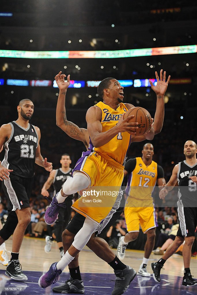 Darius Morris #1 of the Los Angeles Lakers drives to the basket against the San Antonio Spurs at Staples Center in Game Three of the Western Conference Quarterfinals during the 2013 NBA Playoffs on April 26, 2013 in Los Angeles, California.