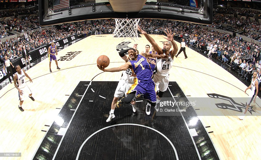 Darius Morris #1 of the Los Angeles Lakers goes to the basket against Tim Duncan #21 of the San Antonio Spurs during the game between the Los Angeles Lakers and the San Antonio Spurs on January 9, 2013 at the AT&T Center in San Antonio, Texas.
