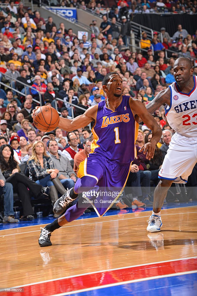Darius Morris #1 of the Los Angeles Lakers handles the ball against <a gi-track='captionPersonalityLinkClicked' href=/galleries/search?phrase=Jason+Richardson+-+Jogador+de+basquetebol+-+Nascido+em+1981&family=editorial&specificpeople=201558 ng-click='$event.stopPropagation()'>Jason Richardson</a> #23 of the Philadelphia 76ers on December 16, 2012 at the Wells Fargo Center in Philadelphia, Pennsylvania.