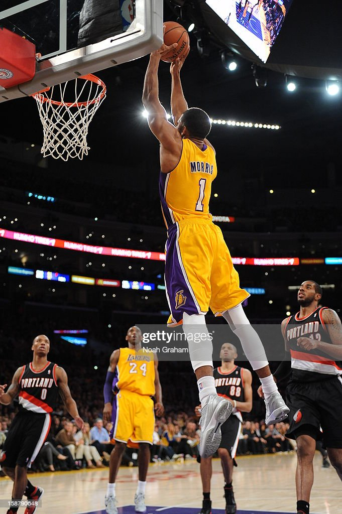 Darius Morris #1 of the Los Angeles Lakers rises for a dunk against the Portland Trail Blazers at Staples Center on December 28, 2012 in Los Angeles, California.