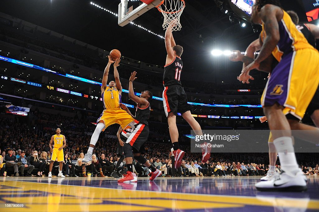 Darius Morris #1 of the Los Angeles Lakers shoots against <a gi-track='captionPersonalityLinkClicked' href=/galleries/search?phrase=Nolan+Smith&family=editorial&specificpeople=4215916 ng-click='$event.stopPropagation()'>Nolan Smith</a> #4 and <a gi-track='captionPersonalityLinkClicked' href=/galleries/search?phrase=Meyers+Leonard&family=editorial&specificpeople=6893999 ng-click='$event.stopPropagation()'>Meyers Leonard</a> #11 of the Portland Trail Blazers at Staples Center on December 28, 2012 in Los Angeles, California.