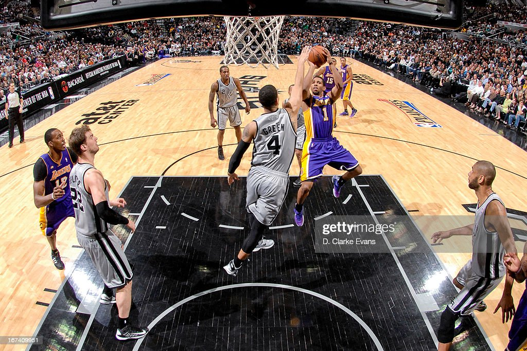 Darius Morris #1 of the Los Angeles Lakers shoots in the lane against Danny Green #4 of the San Antonio Spurs in Game Two of the Western Conference Quarterfinals during the 2013 NBA Playoffs on April 24, 2013 at the AT&T Center in San Antonio, Texas.