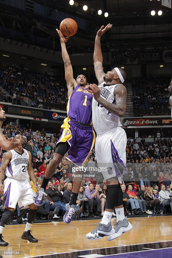 Darius Morris #1 of the Los Angeles Lakers shoots the ball over DeMarcus Cousins #15 of the Sacramento Kings on November 21, 2012 at Sleep Train Arena in Sacramento, California.
