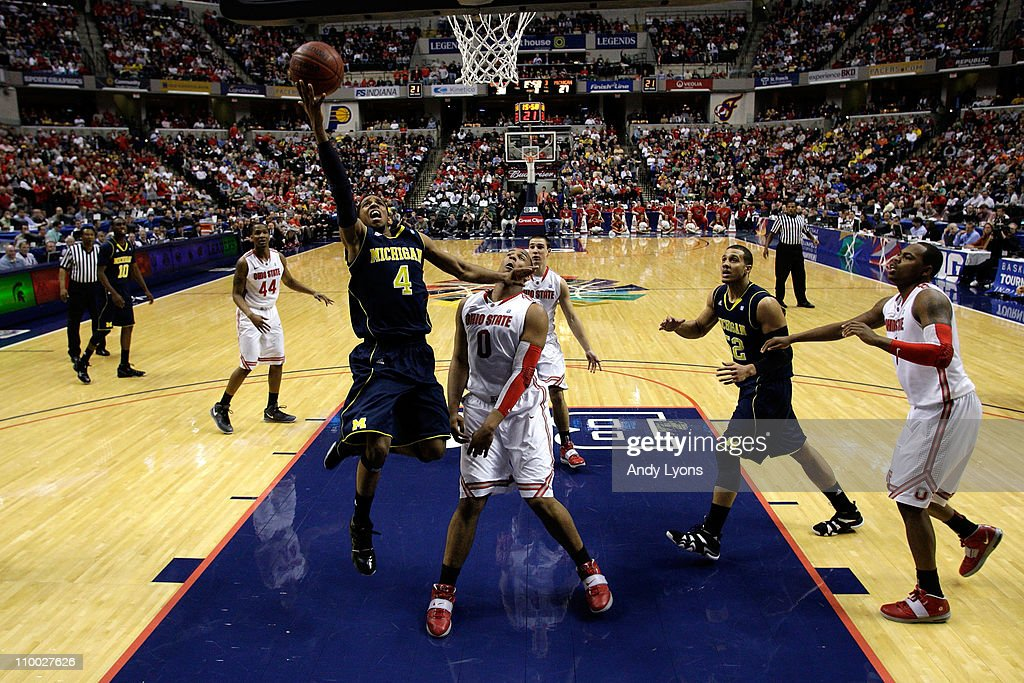 Darius Morris of the Michigan Wolverines attempts a shot against Jared Sullinger of the Ohio State Buckeyes during the semifinals of the 2011 Big Ten...