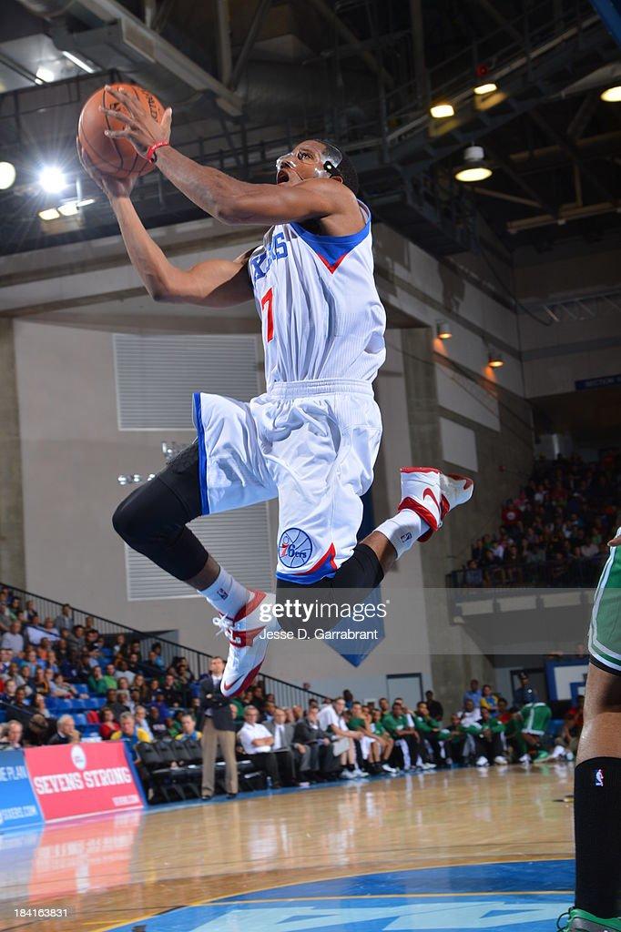 Darius Morris #7 of the Philadelphia 76ers goes to the basket against the Boston Celtics at the Bob Carpenter Center on October 11, 2013 in Newark, Delaware.