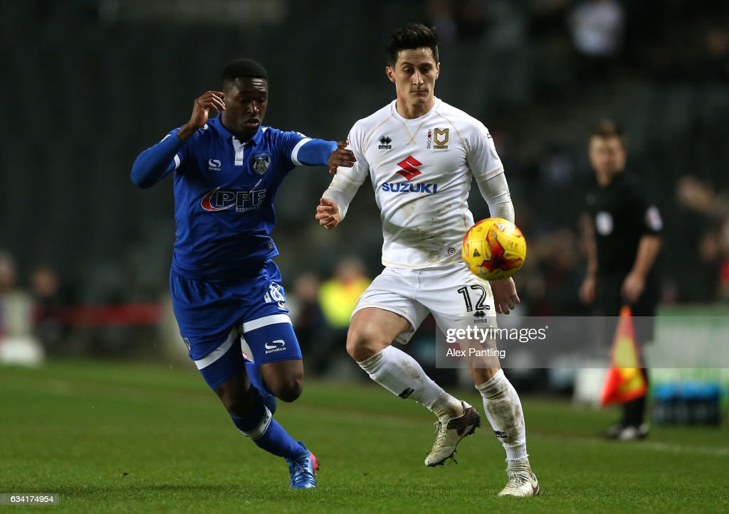 Darius Osei of Oldham Athletic and George Williams of MK Dons in action during the Sky Bet League One match between Milton Keynes Dons and Oldham Athletic at StadiumMK on February 7, 2017 in Milton Keynes, England.