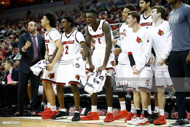 Darius Perry and Lance Thomas of the Louisville Cardinals celebrate after a basket against the Bryant Bulldogs during the game at KFC YUM Center on...
