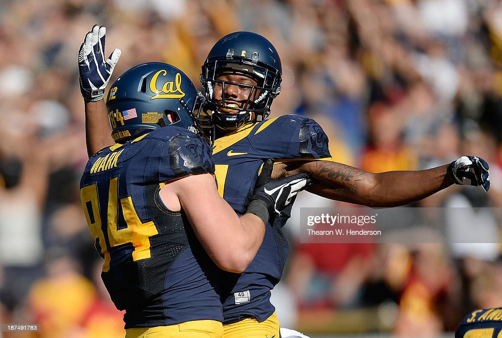 Darius Powe #10 and Jacob Wark #84 of the California Golden Bears celebrates after Powe caught a twenty-four yard touchdown pass against the USC Trojans during the second quarter at California Memorial Stadium on November 9, 2013 in Berkeley, California.