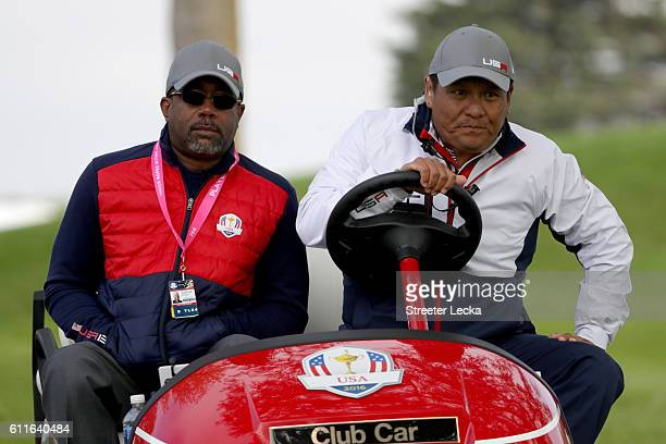 Darius Rucker and Notah Begay III look on during morning foursome matches of the 2016 Ryder Cup at Hazeltine National Golf Club on September 30 2016...