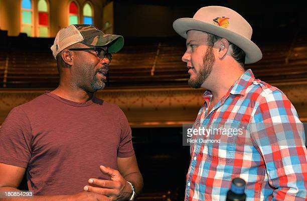 Darius Rucker and OCMS's Critter Fuqua chat during Darius Rucker and Old Crow Medicine Show's Ketch Secor Celebrate their No1 Song 'Wagon Wheel' at...