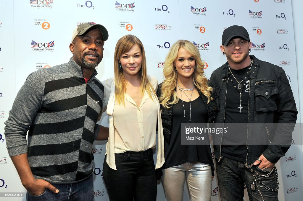 <a gi-track='captionPersonalityLinkClicked' href=/galleries/search?phrase=Darius+Rucker&family=editorial&specificpeople=215161 ng-click='$event.stopPropagation()'>Darius Rucker</a>, LeAnn Rimes, <a gi-track='captionPersonalityLinkClicked' href=/galleries/search?phrase=Carrie+Underwood&family=editorial&specificpeople=204483 ng-click='$event.stopPropagation()'>Carrie Underwood</a> and <a gi-track='captionPersonalityLinkClicked' href=/galleries/search?phrase=Brantley+Gilbert&family=editorial&specificpeople=7035830 ng-click='$event.stopPropagation()'>Brantley Gilbert</a> pose backstage before their performances as part of the Country 2 Country tour at O2 Arena on March 17, 2013 in London, England.