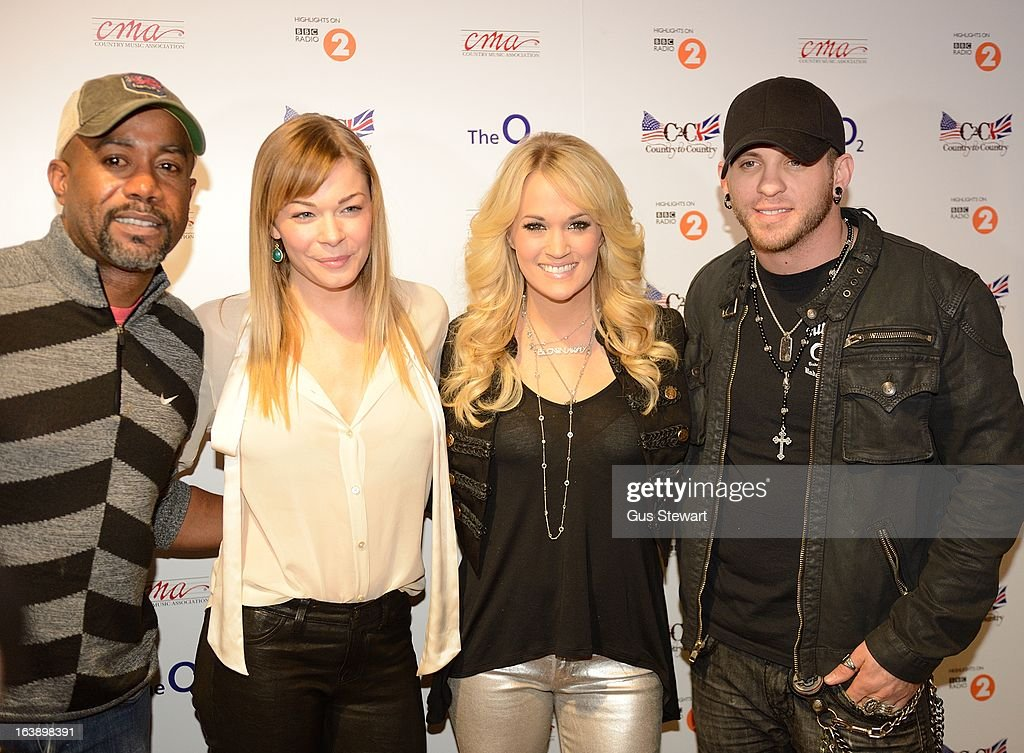 <a gi-track='captionPersonalityLinkClicked' href=/galleries/search?phrase=Darius+Rucker&family=editorial&specificpeople=215161 ng-click='$event.stopPropagation()'>Darius Rucker</a>, Leann Rimes, <a gi-track='captionPersonalityLinkClicked' href=/galleries/search?phrase=Carrie+Underwood&family=editorial&specificpeople=204483 ng-click='$event.stopPropagation()'>Carrie Underwood</a> and <a gi-track='captionPersonalityLinkClicked' href=/galleries/search?phrase=Brantley+Gilbert&family=editorial&specificpeople=7035830 ng-click='$event.stopPropagation()'>Brantley Gilbert</a> attend the Country 2 Country tour at O2 Arena on March 17, 2013 in London, England.
