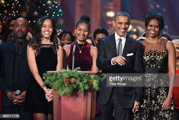 Darius Rucker Malia Obama Sasha Obama US President Barack Obama and First Lady Michelle Obama speak onstage at TNT Christmas in Washington 2014 at...