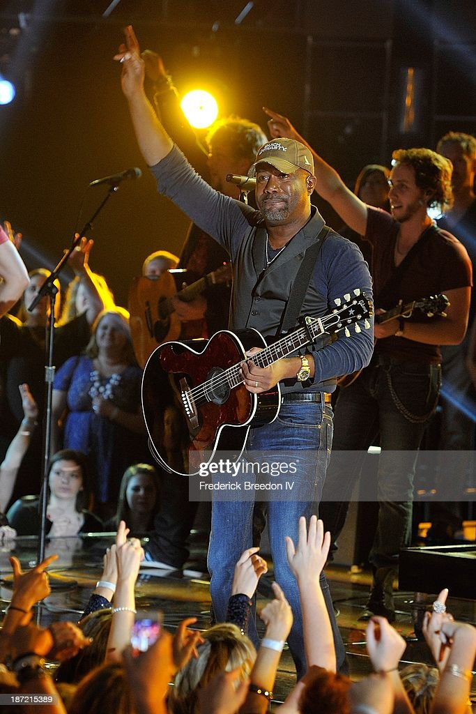 <a gi-track='captionPersonalityLinkClicked' href=/galleries/search?phrase=Darius+Rucker&family=editorial&specificpeople=215161 ng-click='$event.stopPropagation()'>Darius Rucker</a> performs during the 47th annual CMA awards at the Bridgestone Arena on November 6, 2013 in Nashville, Tennessee.
