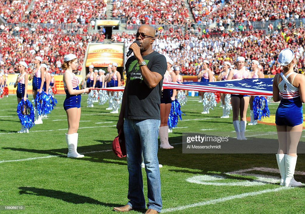Darius Rucker sings the National Anthem before the Michigan Wolverines play against the South Carolina Gamecocks in the Outback Bowl January 1, 2013 at Raymond James Stadium in Tampa, Florida.