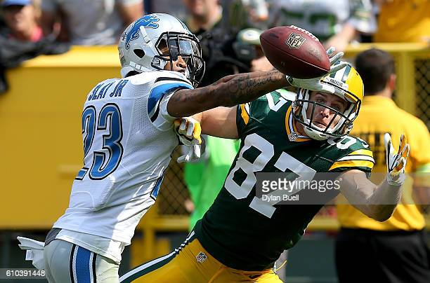Darius Slay of the Detroit Lions breaks up a pass intended for Jordy Nelson of the Green Bay Packers in the second quarter at Lambeau Field on...
