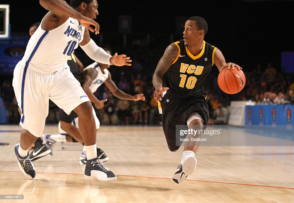 Darius Theus #10 of the VCU Rams dribbles against Tarik Black #10 of the Memphis Tigers during the Battle 4 Atlantis tournament at Atlantis Resort on November 22, 2012 in Nassau, Paradise Island, Bahamas.
