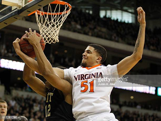 Darius Thompson of the Virginia Cavaliers in action during the game against Chris Jones of the Pittsburgh Panthers at Petersen Events Center on...