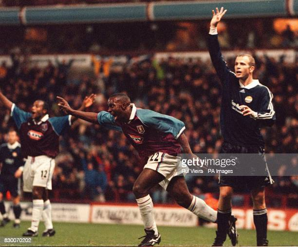 FEATURE Darius Vassell celebrates after scoring Aston Villa's equalizer against Stromsgodset while Thomas Waehler protests during the UEFA Cup First...