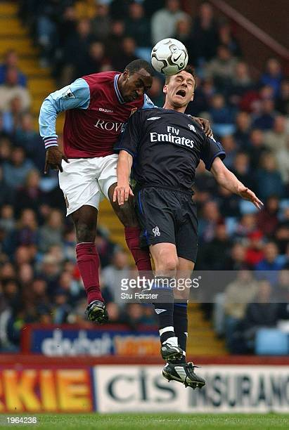 Darius Vassell of Aston Villa beats John Terry of Chelsea to the ball in the air during the FA Barclaycard match between Aston Villa and Chelsea held...