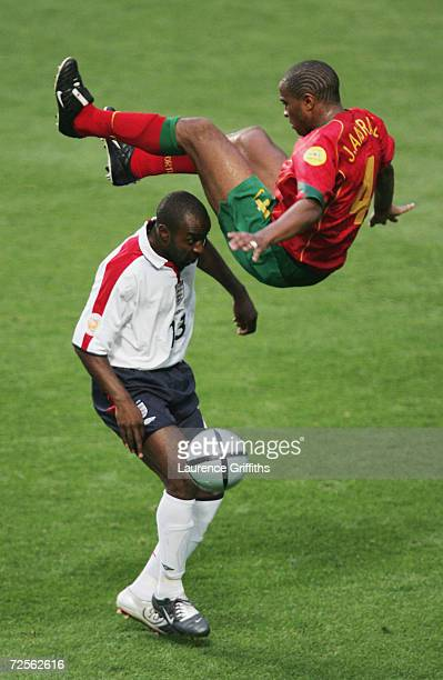 Darius Vassell of England battles for the ball with Jorge Andrade of Portugal during the UEFA Euro 2004 Quarter Final match between Portugal and...
