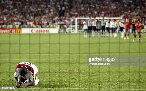 Darius Vassell of England misses his penalty during the UEFA Euro 2004 Quarter Final match between Portugal and England at the Luz Stadium on June 24...
