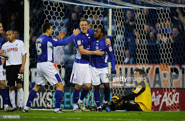 Darius Vassell of Leicester celebrates scoring to make it 21 with team mates Michael Morrison and Bruno Berner during the npower Championship match...