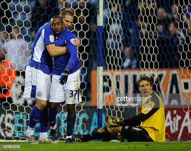 Darius Vassell of Leicester celebrates scoring to make it 21 with team mate Michael Morrison as Dorus de Vries of Swansea looks on during the npower...
