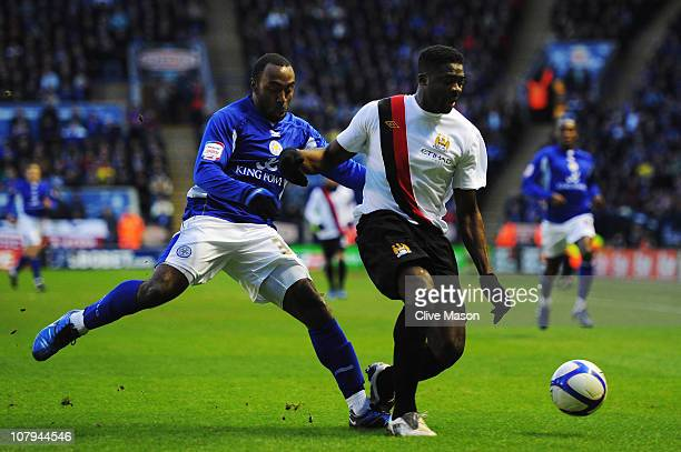 Darius Vassell of Leicester City challenges Kolo Toure of Manchester City during the FA Cup sponsored by EON 3rd Round match between between...
