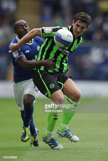 Darius Vassell of Leicester is challenged by Lewis Dunk of Brighton during the npower Championship match between Leicester City and Brighton Hove...