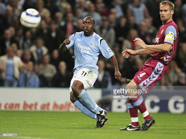 Darius Vassell of Man City beats Olof Mellberg of Aston Villa to score his second goal during the Barclays Premiership match between Manchester city...