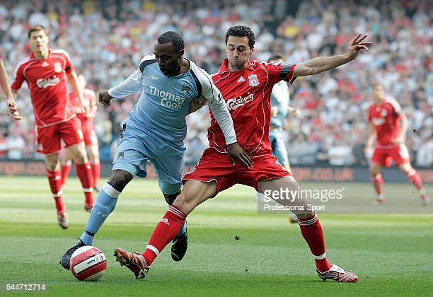 Darius Vassell of Manchester City and Alvaro Arbeloa of Liverpool in action during the FA Premier League match between Manchester City and Liverpool...