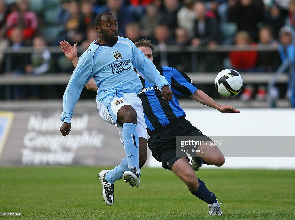 Darius Vassell of Manchester City is challenged by Frodi Clementsen of EB/Streymur during the UEFA Cup 1st Round 1st Leg Qualifying match between...
