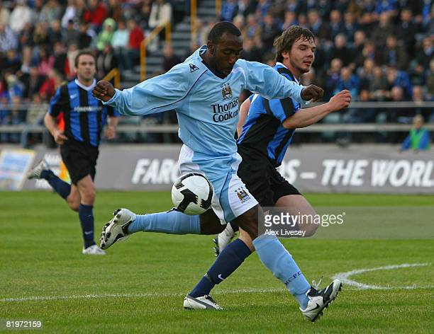 Darius Vassell of Manchester City is challenged by Marni Djurhuus of EB/Streymur during the UEFA Cup 1st Round 1st Leg Qualifying match between...
