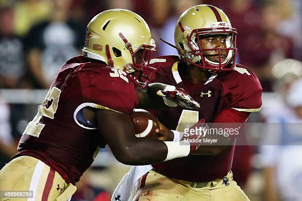 Darius Wade of the Boston College Eagles hands the ball off to Jon Hilliman during the second quarter against the Florida State Seminoles at Alumni...