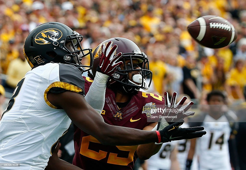 Darius White #8 of the Missouri Tigers attempts a reception against Briean Boddy-Calhoun #29 of the Minnesota Golden Gophers during the Buffalo Wild Wings Citrus Bowl at the Florida Citrus Bowl on January 1, 2015 in Orlando, Florida.