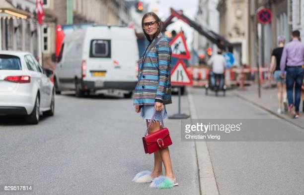 Darja Barannik wearing a denim skirt red Gucci skirt striped blazer outside Baum Und Pferdgarten on August 10 2017 in Copenhagen Denmark