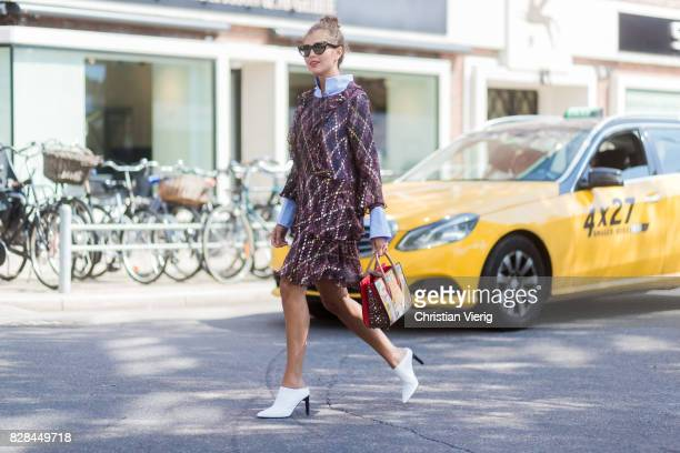 Darja Barannik wearing a dress outside Munthe on August 09 2017 in Copenhagen Denmark