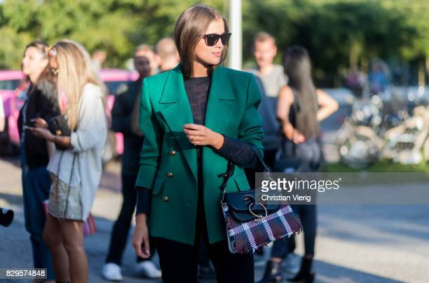 Darja Barannik wearing a green blazer jacket JW Anderson bag outside Saks Potts on August 10 2017 in Copenhagen Denmark