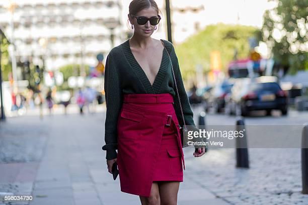Darja Barannik wearing an olive v neck sweater red skirt outside Ida Sjöstedt during the second day of the Stockholm Fashion Week Spring/Summer 2017...