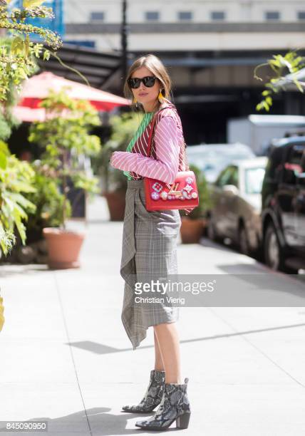 Darja Barannik wearing checked skirt striped top red Louis Vuitton bag scarf in her hair seen in the streets of Manhattan outside Tibi during New...