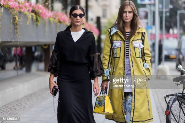 Darja Barannik wearing yellow Edda coat bag and sock boots outside Jennifer Bloom on August 31 2017 in Stockholm Sweden