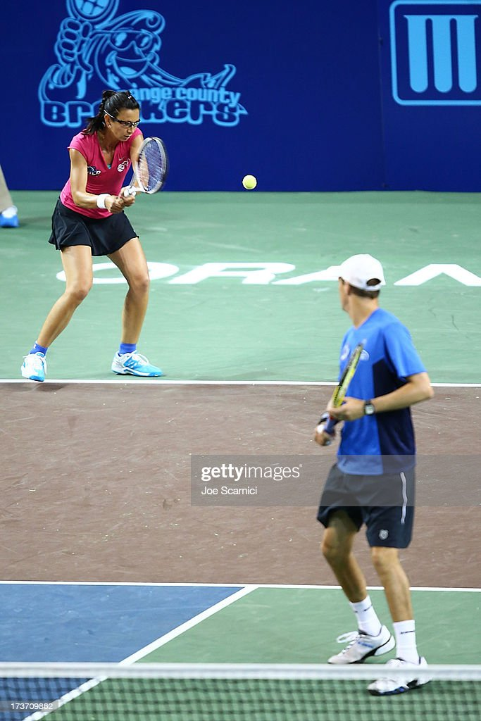 Darja Jurak plays a backhand as <a gi-track='captionPersonalityLinkClicked' href=/galleries/search?phrase=Mike+Bryan+-+Tennis+Player&family=editorial&specificpeople=204456 ng-click='$event.stopPropagation()'>Mike Bryan</a> watches as the Texas Wild compete against the Orange County Breakers on July 16, 2013 in Newport Beach, California.